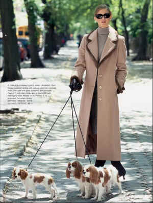 Ad woman walking with 3 blenheims